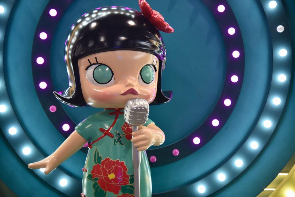 A figurine doing karaoke.